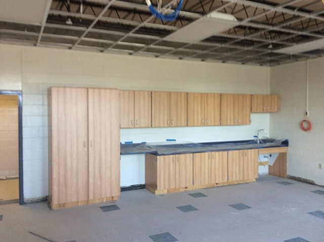 Photo of classroom renovations with new flooring and cabinetry