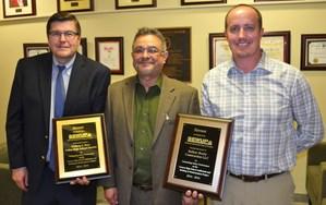 John Rodriguez presents award to Mike Otavka and Wayne Roemhild