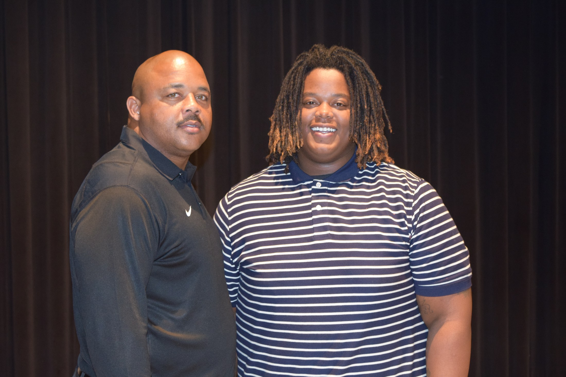 Coach Johnson and student on signing day