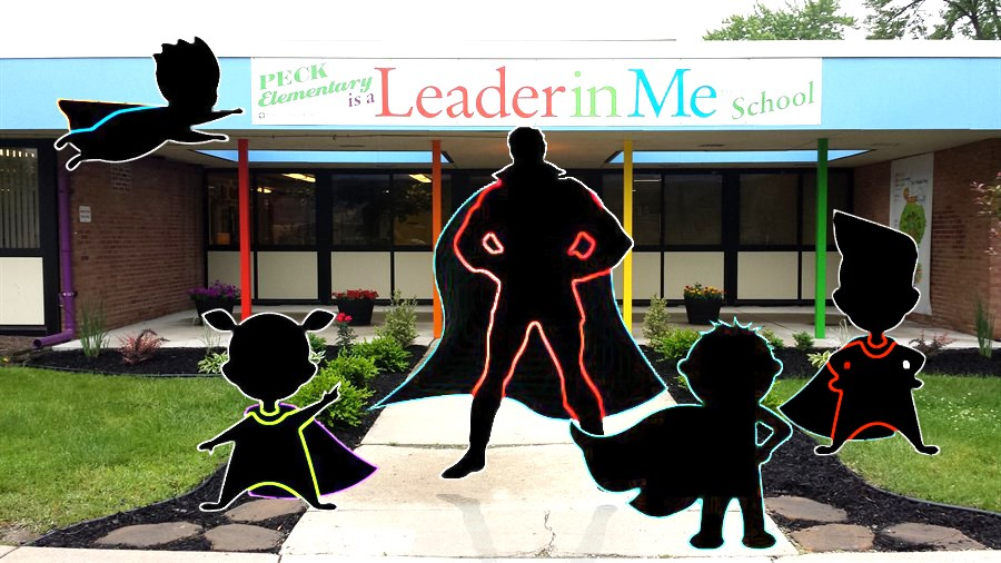 Superhero figures in front of Peck Elementary