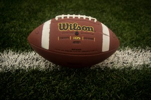 Image of a football on a grass field