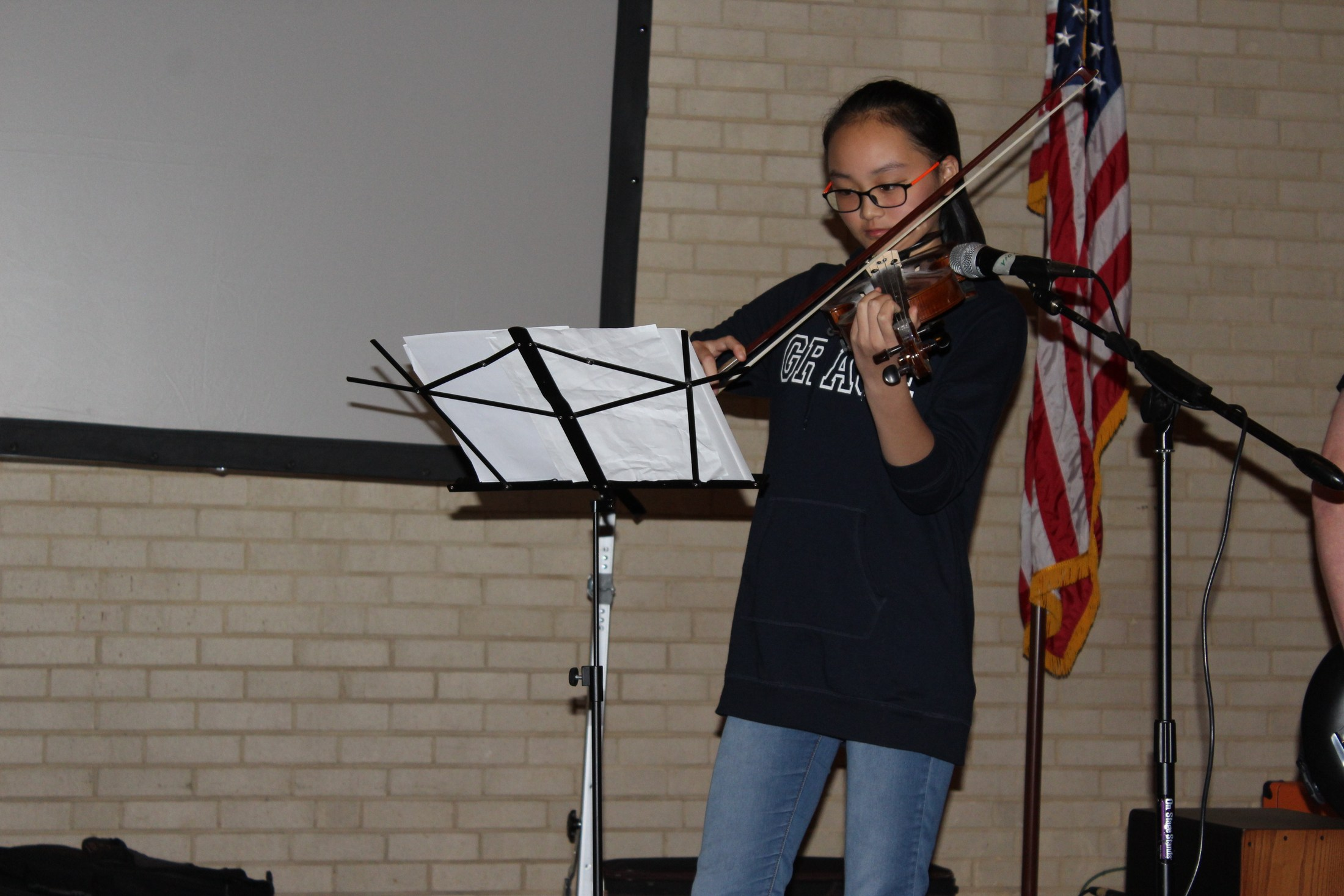 Exchange student playing violin at Rock Ensemble concert.