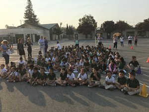 large group of students gathered for assembly outside, image 3