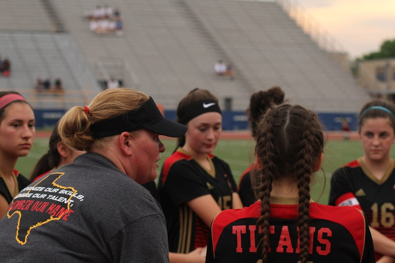vehs Head Girls Soccer Coach, Misty Boenig, talking to her team on the soccer field