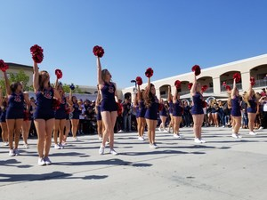Cheerleaders in the quad during the rolling rally