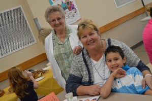 Kindergarteners and their moms at muffins for moms and grandmas.