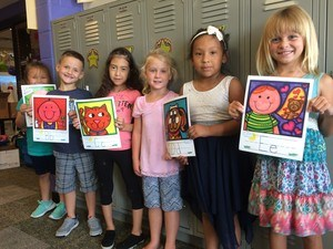 Students showing artwork