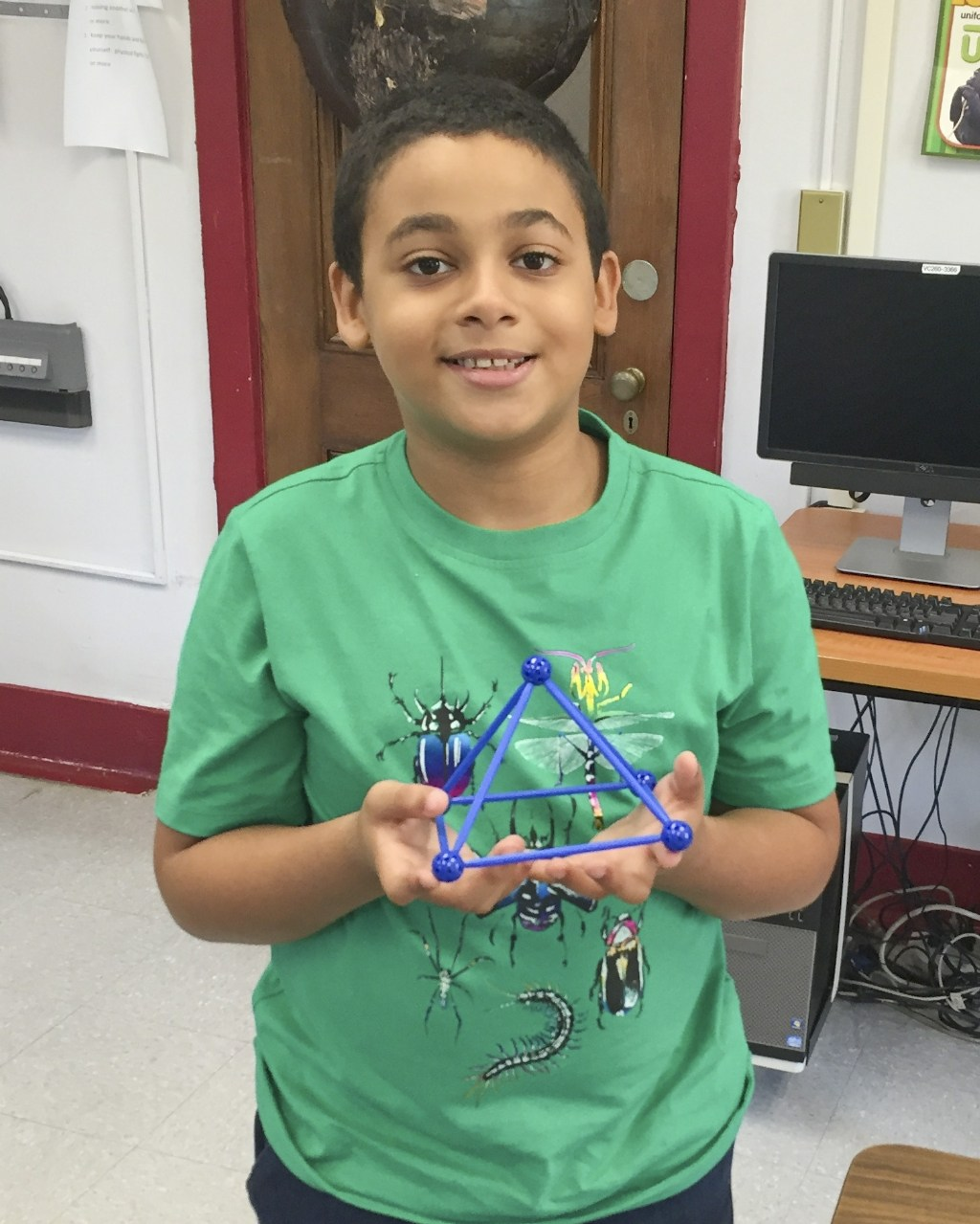 Student showing off his project
