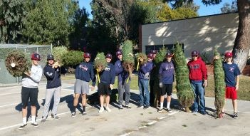 baseball team donating trees to families