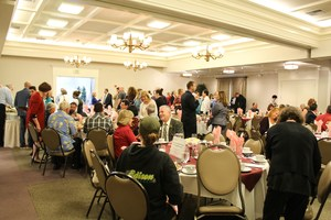The banquet hall is filled with certificated employees and their loved ones.