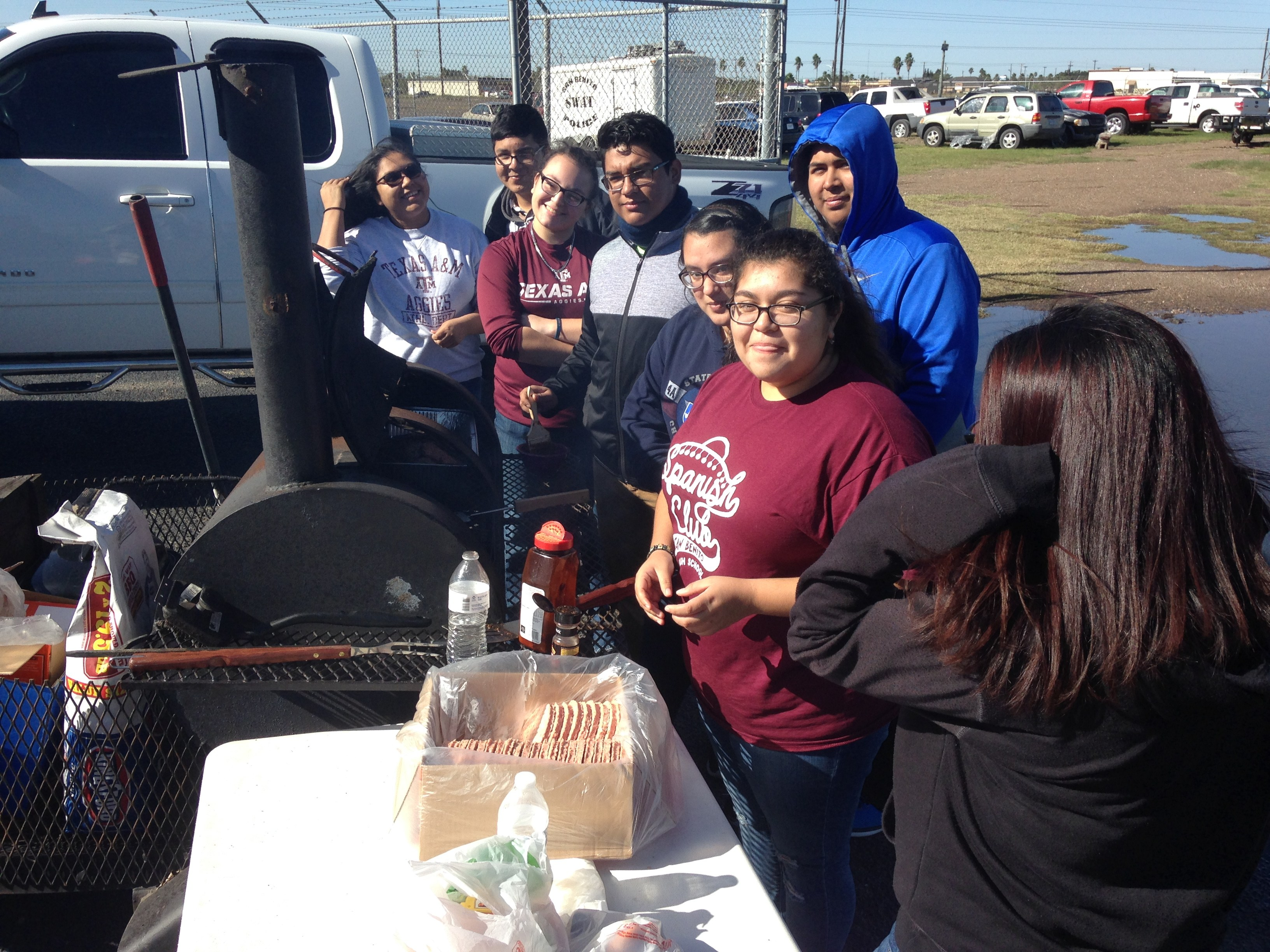 students in Mr. Means criminal justice club are shown bbqing burgers