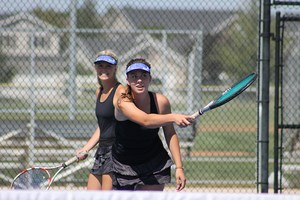 Girl's Tennis players practice.