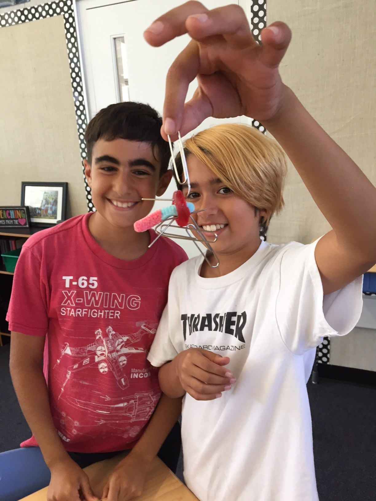 Students holding up science experiment.