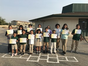 group of students receiving student of the month recognition