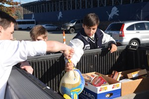 Students load food into truck
