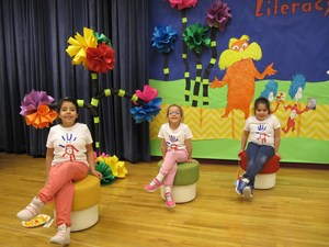 Students on stage in front of Dr. Seuss background