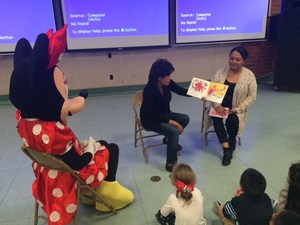 Preschoolers reading with Minney Mouse