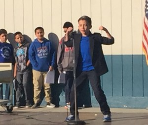"""BPUSD_POET_2: Margaret Heath Elementary School fifth-grader Leonardo Arreola read a poem he wrote during the school's annual Poetry Festival, held Feb. 16, proclaiming himself """"as strong as a bear."""""""