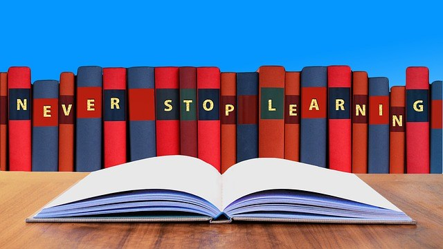 "books with ""never stop learning"" written across them"