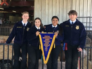 Wapato High School FFA students holding 1st place banner