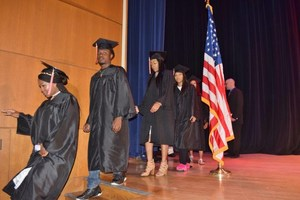 Invictus High School students walk the stage