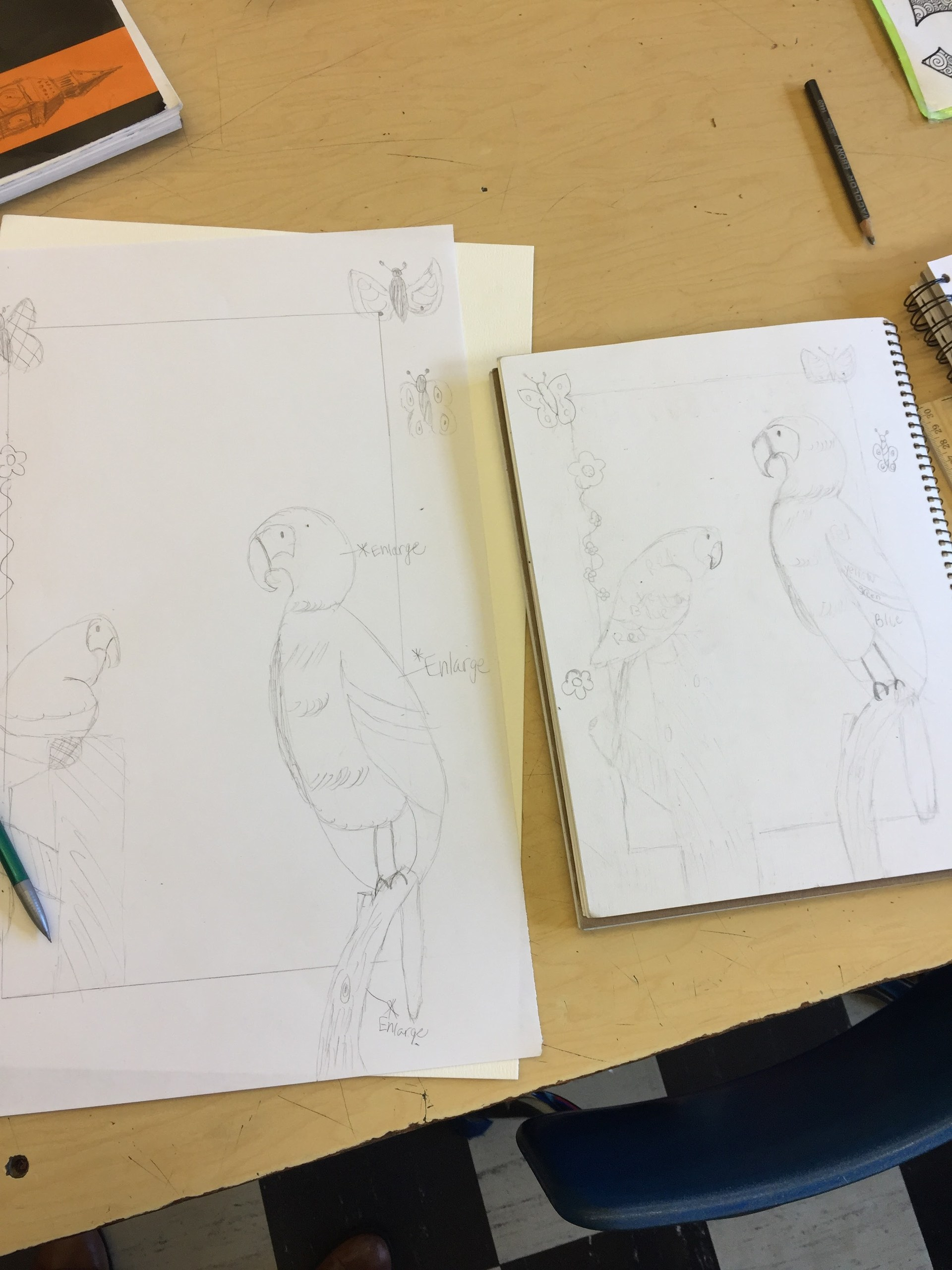 8th graders working on 'Beyond the Border' watercolors