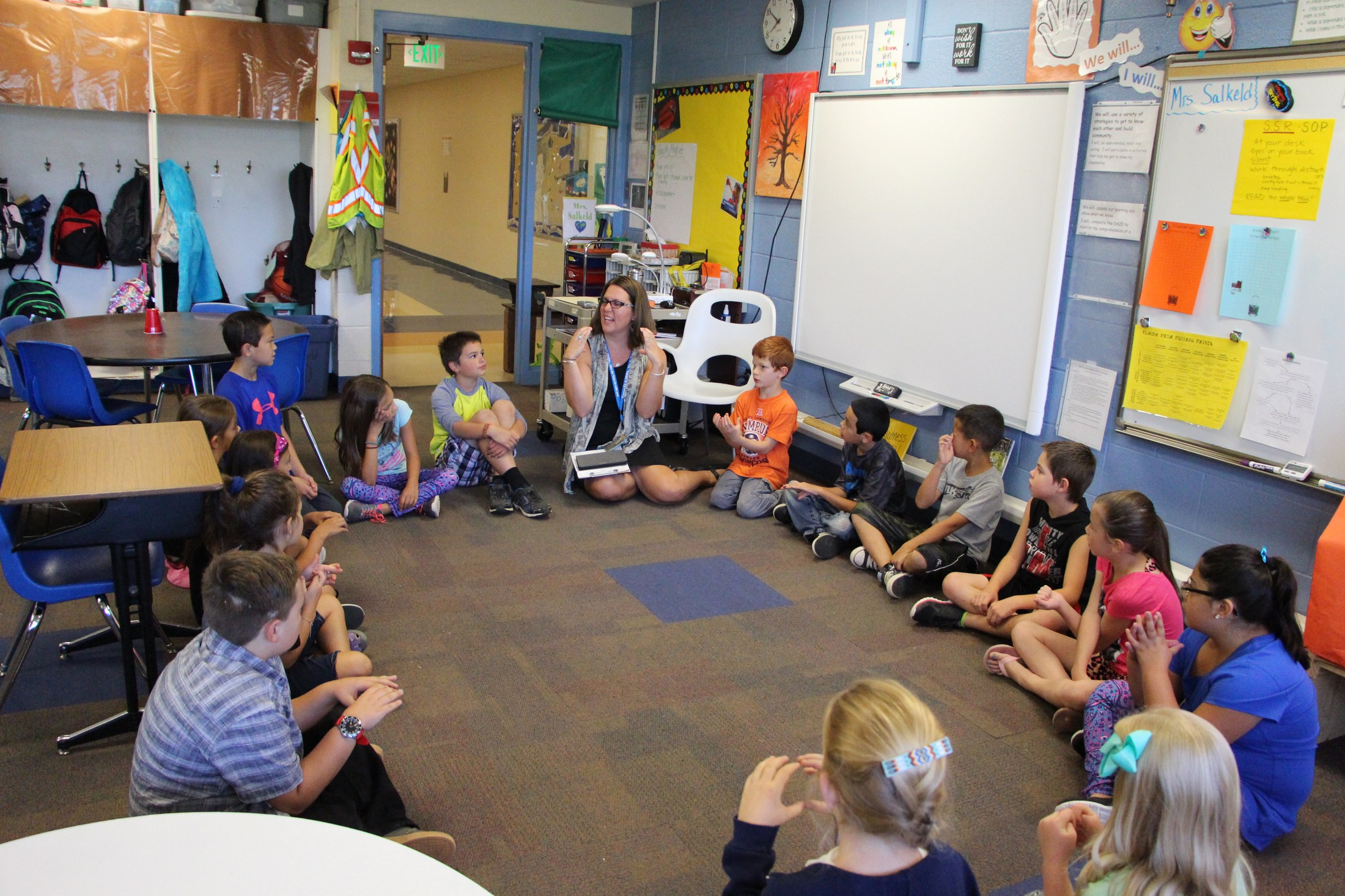 Students and teacher in a 3rd grade classroom.