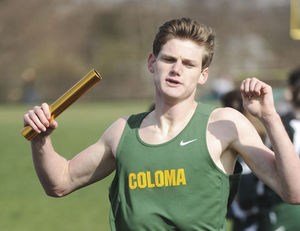 Coloma's Josh Young anchors and wins the 3200 meter relay during Wednesday's double dual meet.