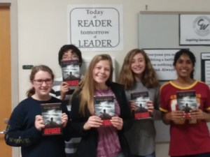 7th Graders holding books REFUGEE