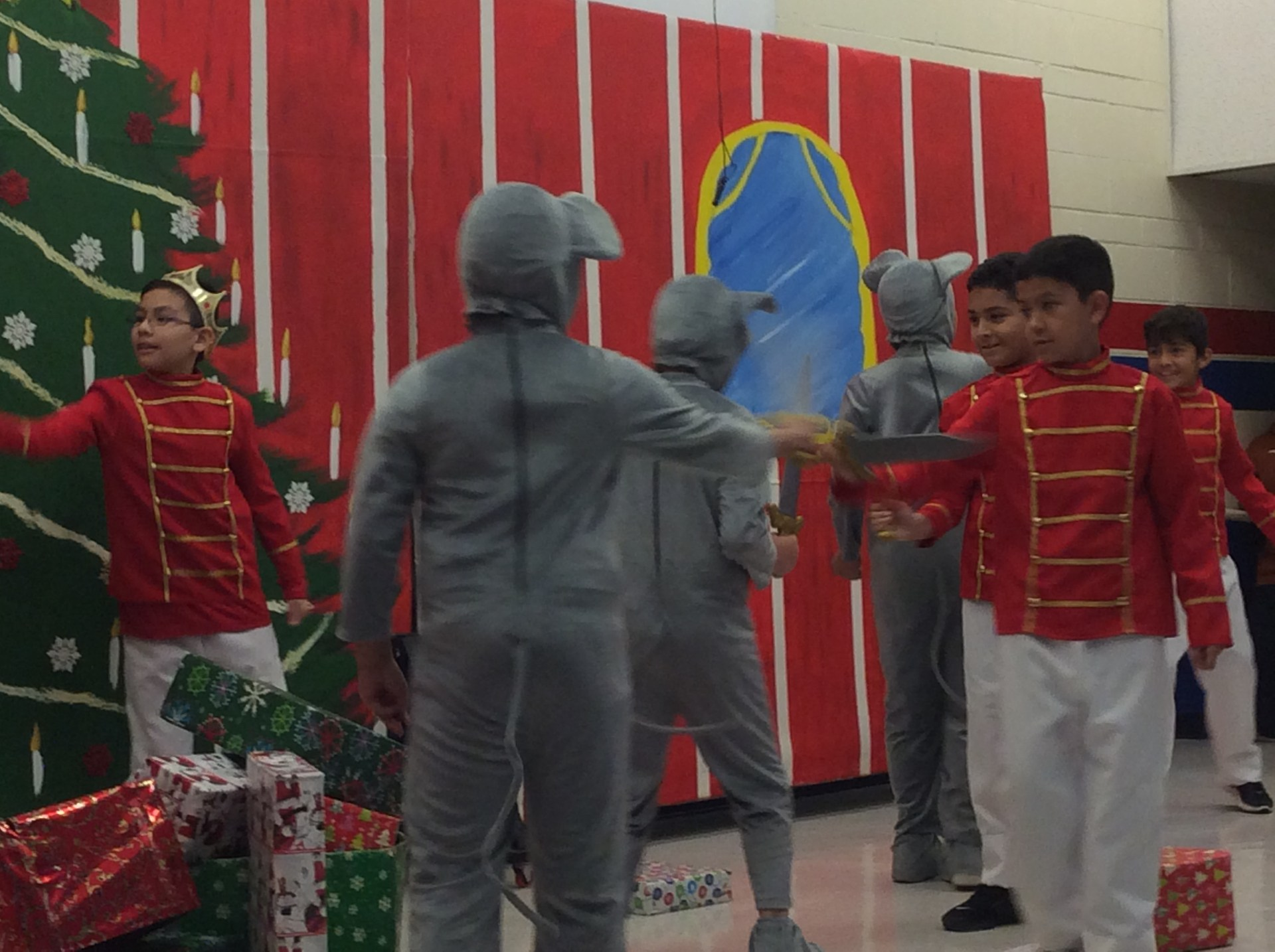 Soldiers and mice characters at sword fight on stage.