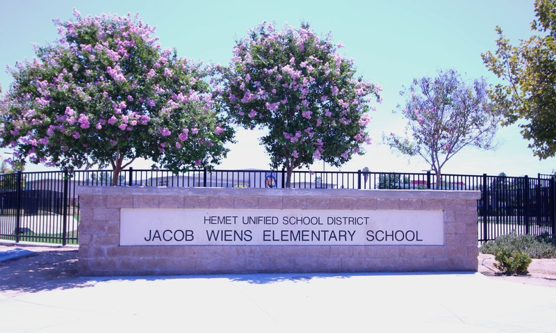 Jacob Wiens Elementary sign in front of the school.