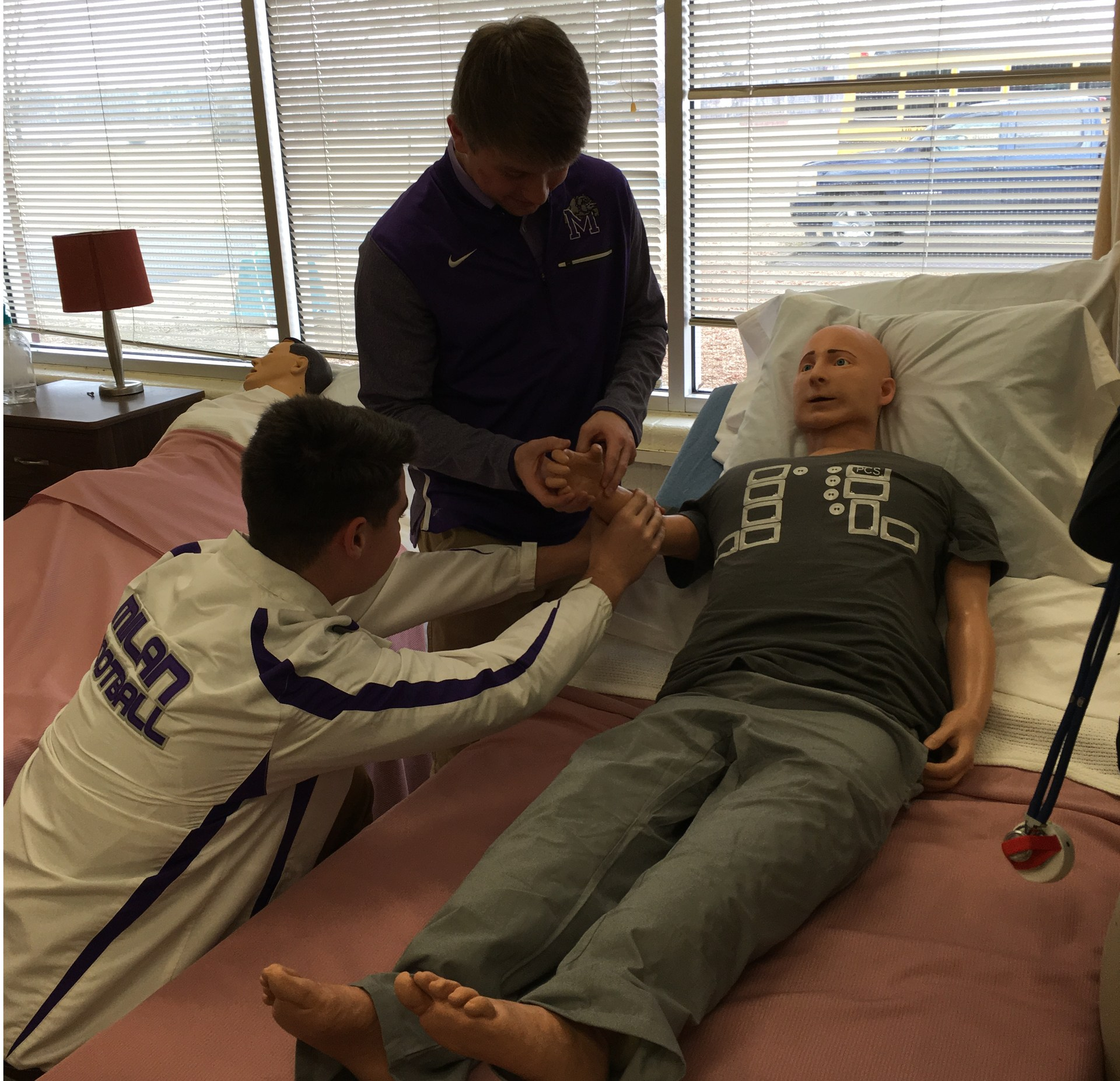 students practicing with patients