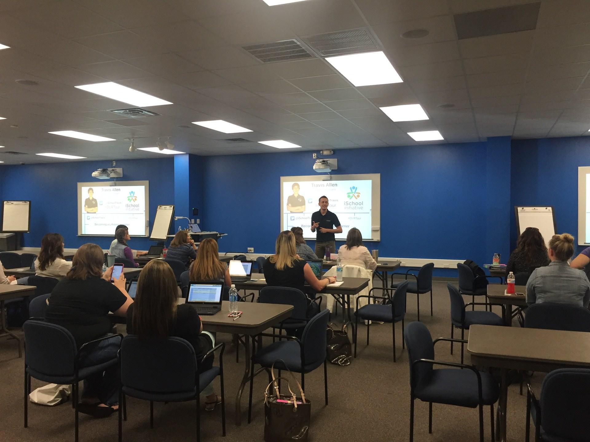 Teachers participate in the iSchool program with Travis Allen