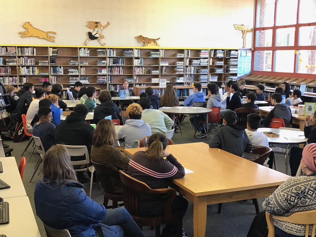 Image of students listening to author, Eric Lindstrom