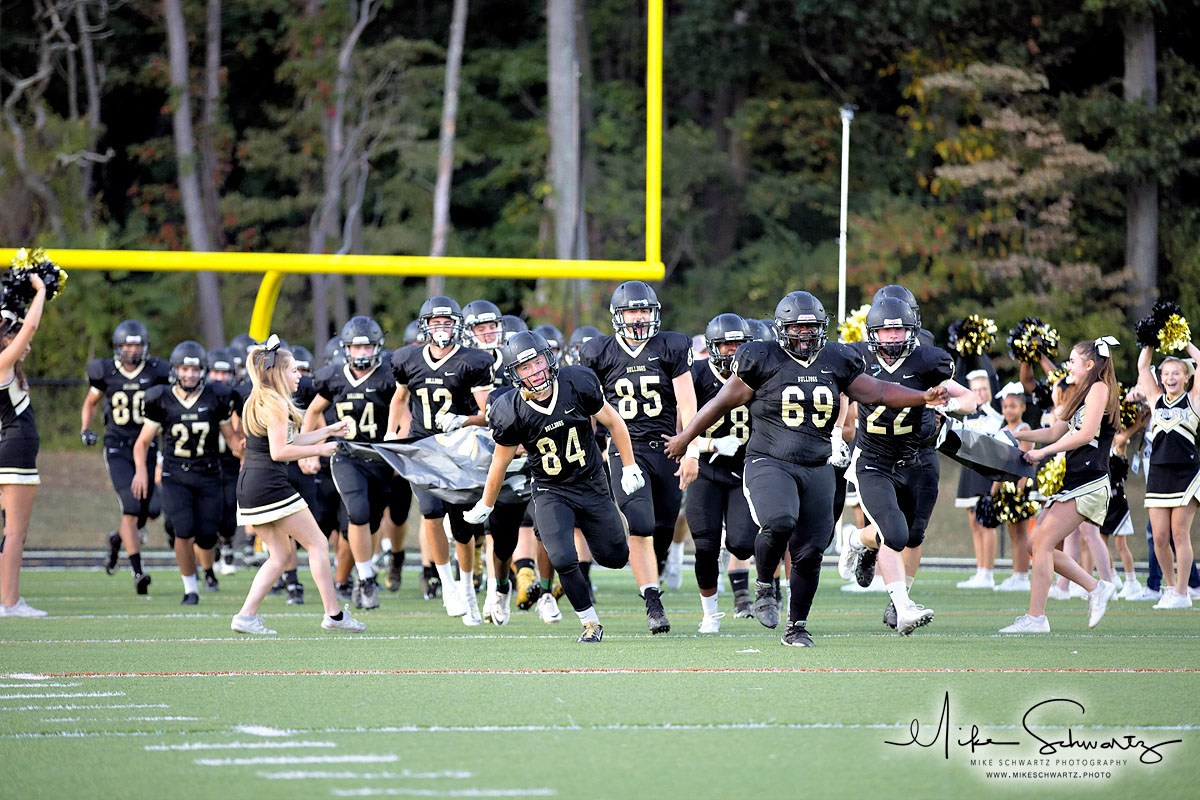 CHS football team races onto field at beginning of game