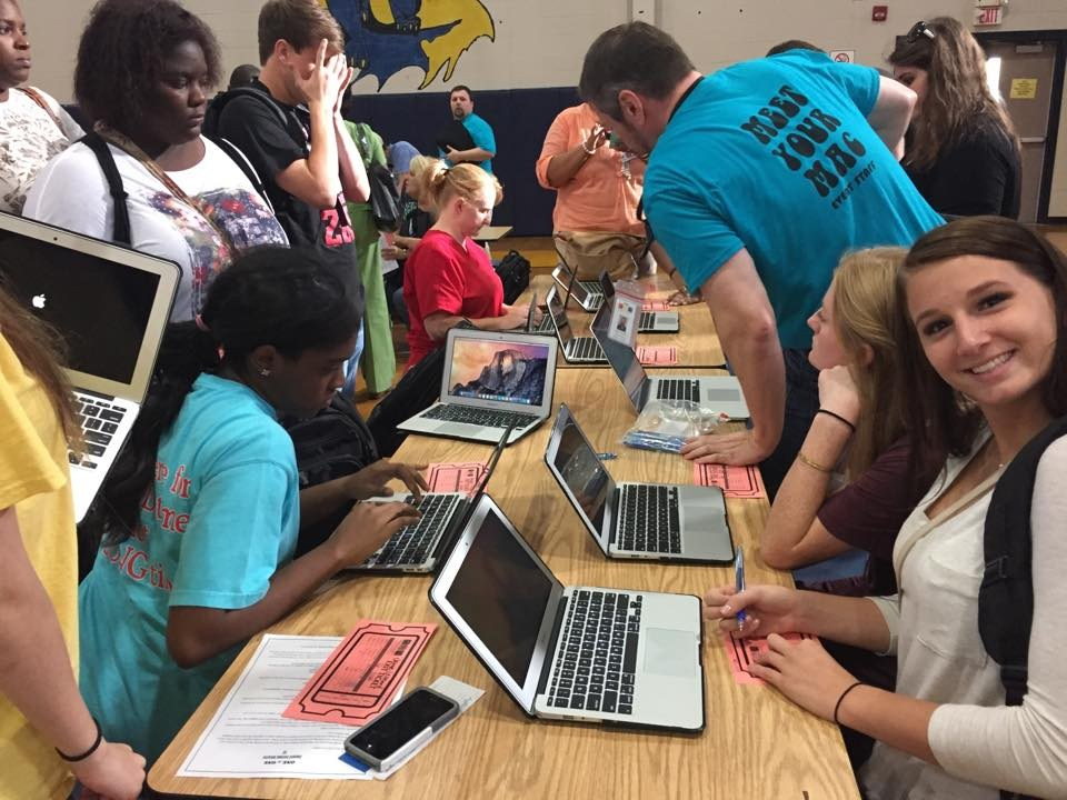 Students enjoying their new MacBooks in the rollout