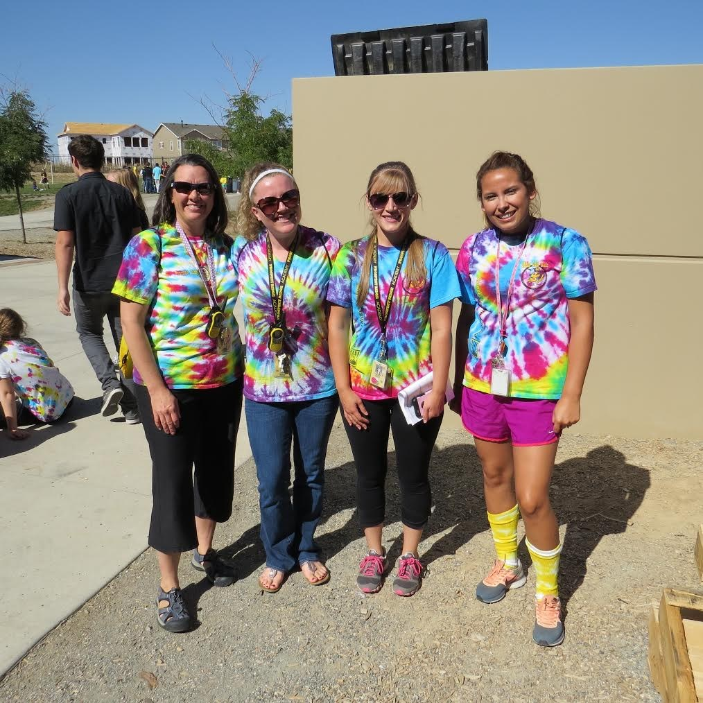 Picture of four 2nd grade teachers wearing tie dye shirts