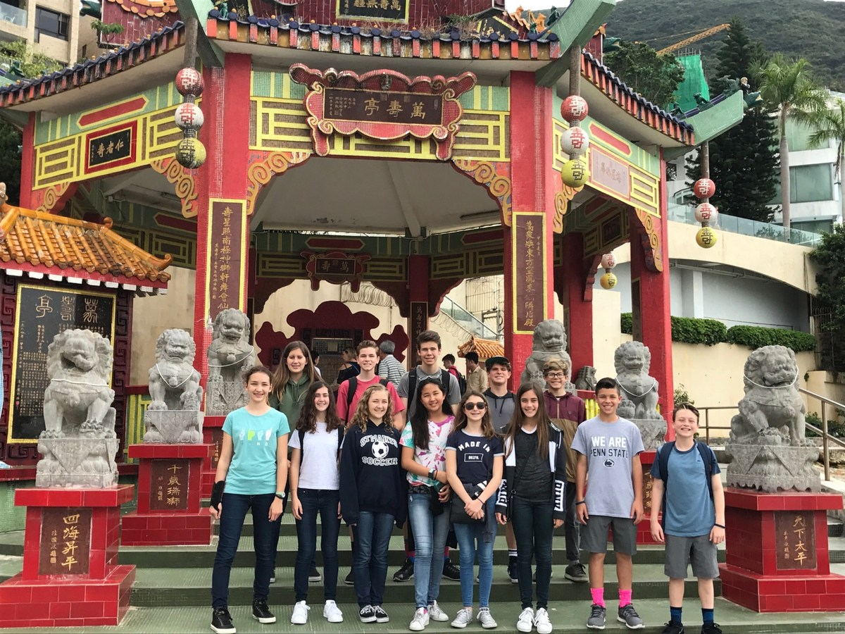 Students in Hong Kong in front of pagoda
