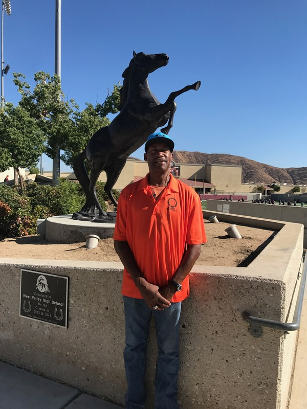 Jerome King in front of the West Valley Mustang statue