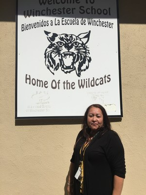 Isabella Lopez in front of a Winchester Elementary sign.