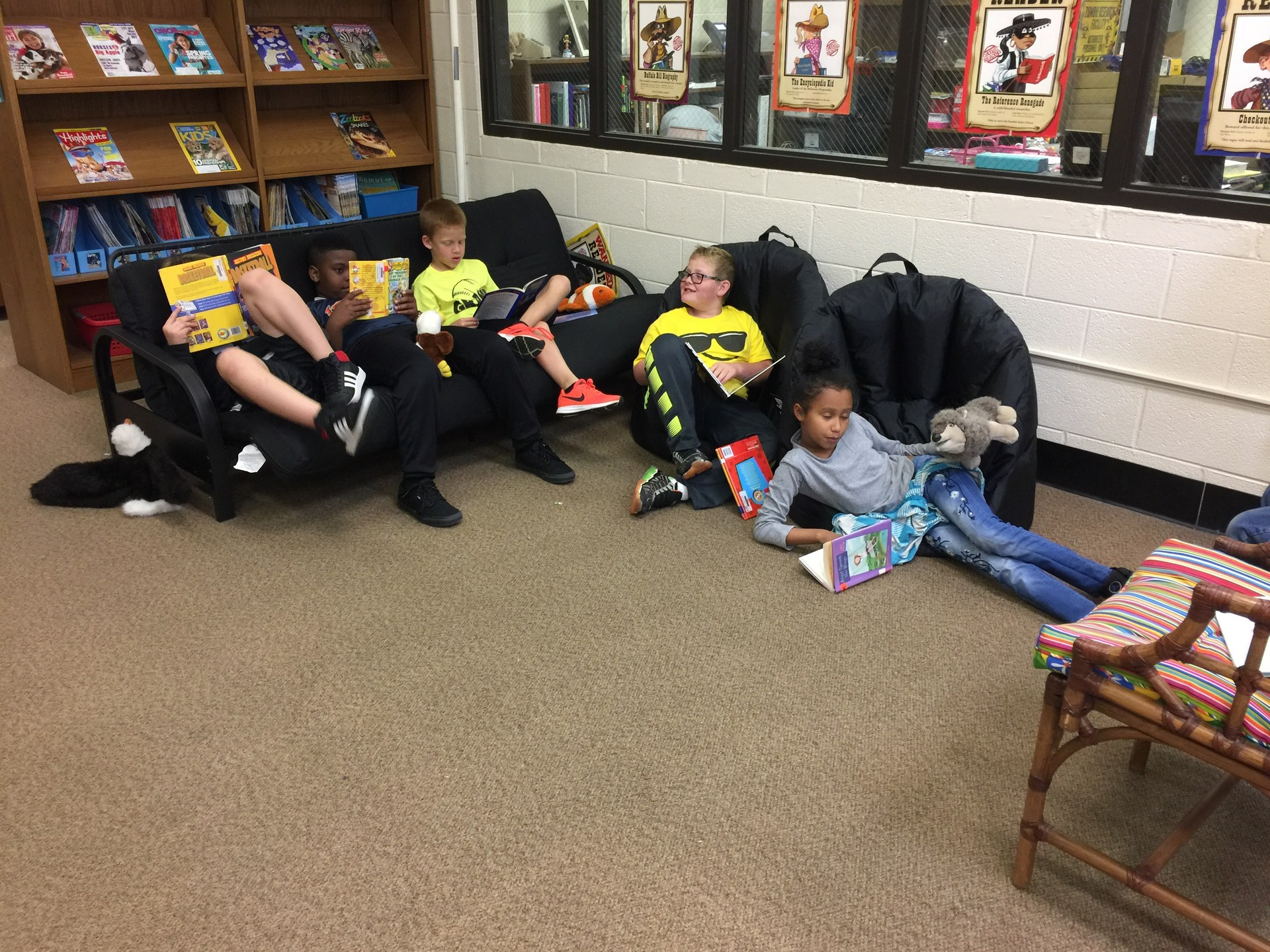 Students relaxing and reading for fun in the library at Midway Elementary.