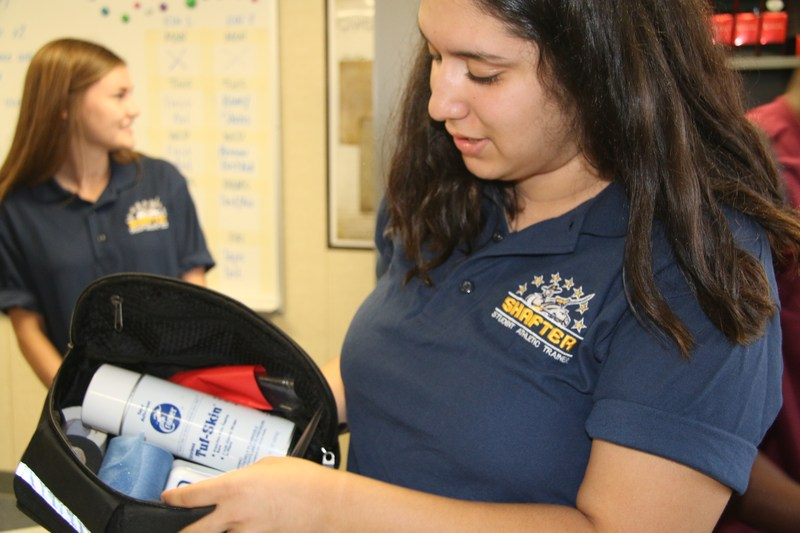 Shafter students taking inventory of supplies
