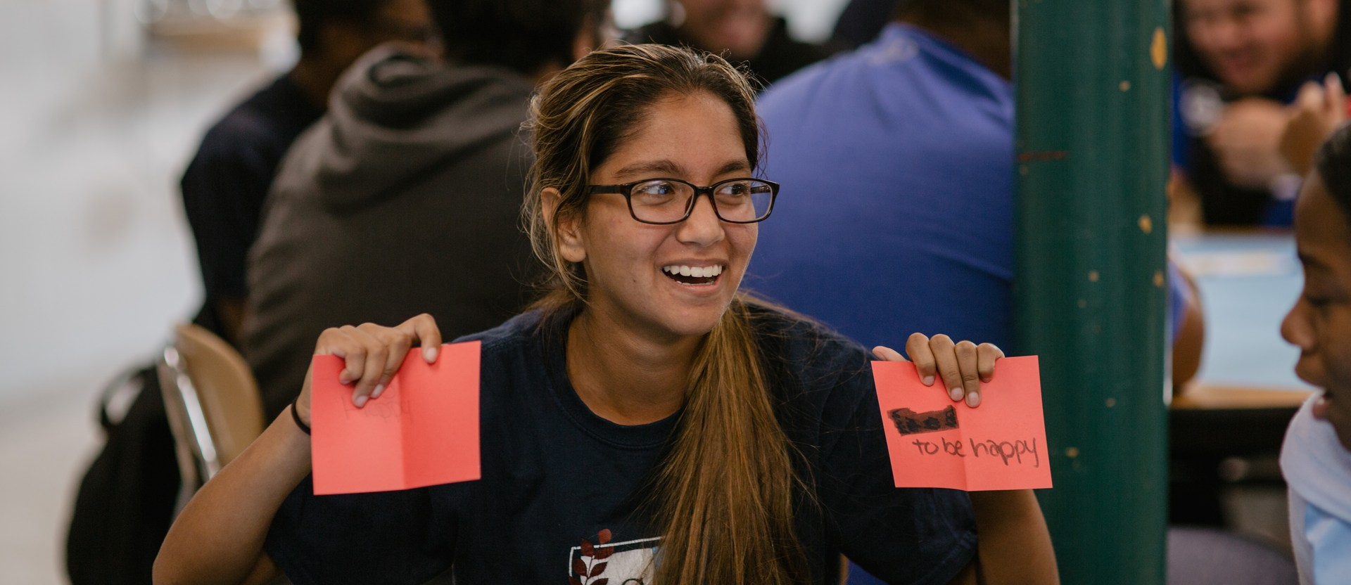 Student holding up flashcards