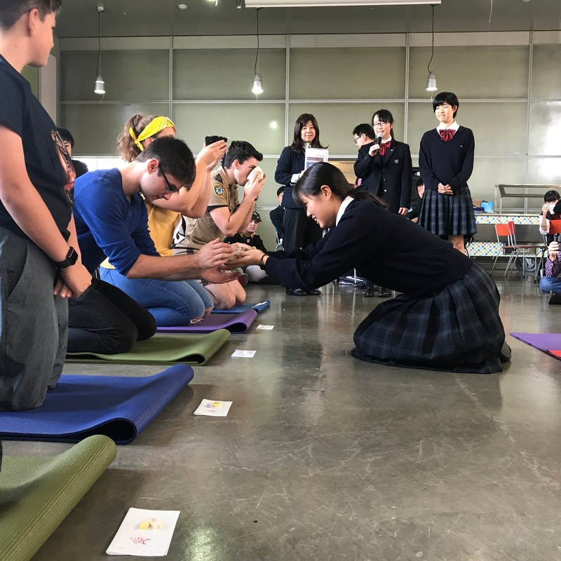 Visiting students from Japan demonstrate Japanese tea ceremony for ESHS students.