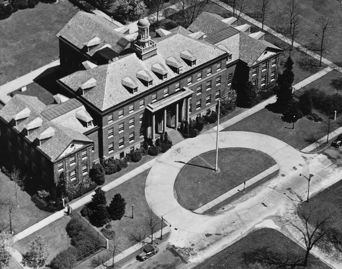 Aerial view of the Schermerhorn Hall building with the original flagpole off Pelham Parkway