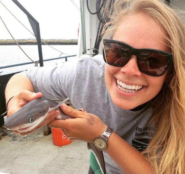Ms. Ickes holding a baby sevengill shark