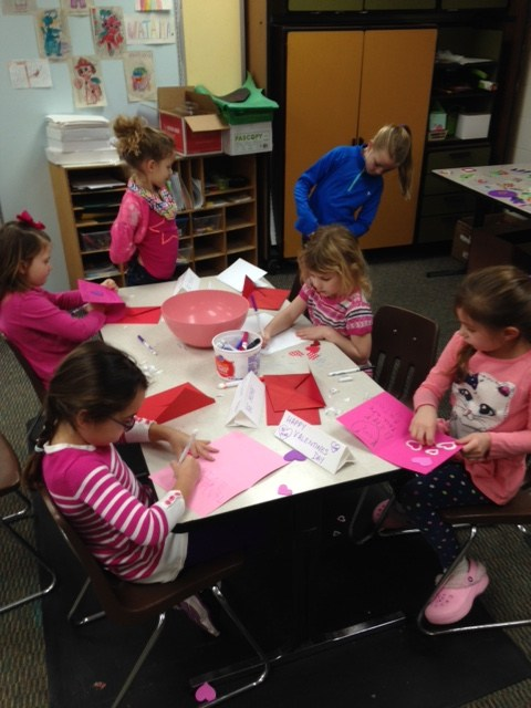 Girls making a craft project.
