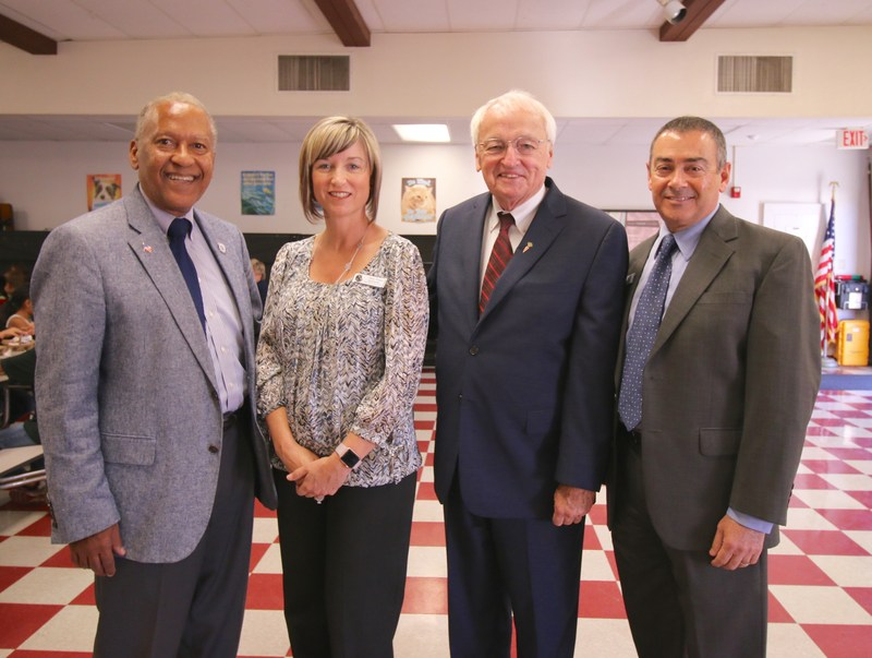 Supervisor Chuck Washington, Superintendent Christi Barrett, Under Secretary for Food, Nutrition, and Consumer Services for USDA Kevin Concannon, and Assistant Superintendent Vince Christakos.