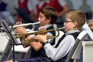 Students playing instruments in the band