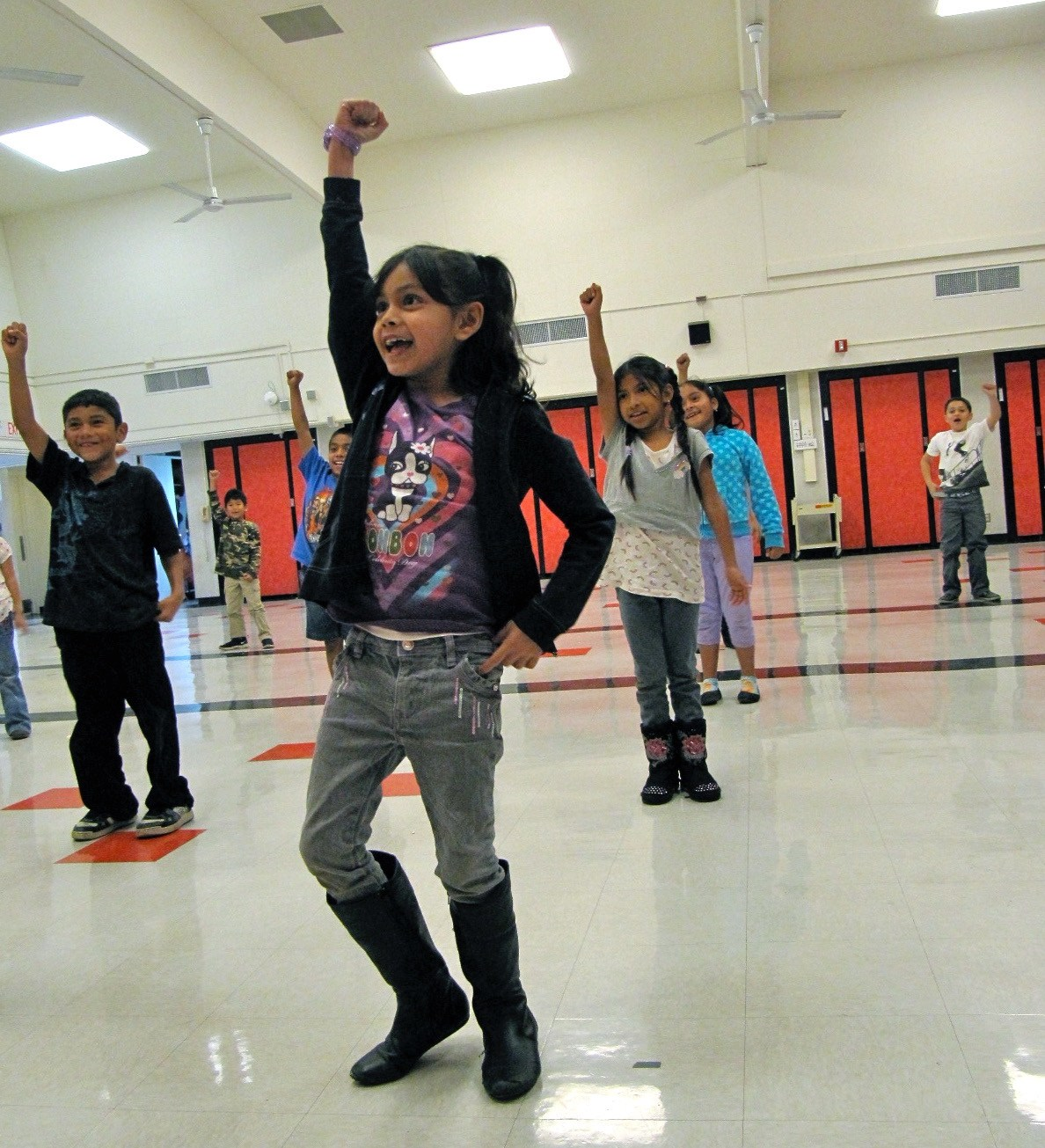 Students doing dance moves in a dance class.